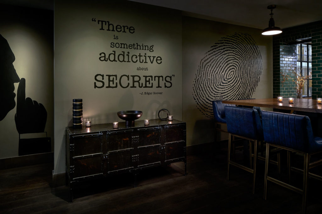"Wall decal reading ""There is something addictive about secrets"" by J. Edgar Hoover"